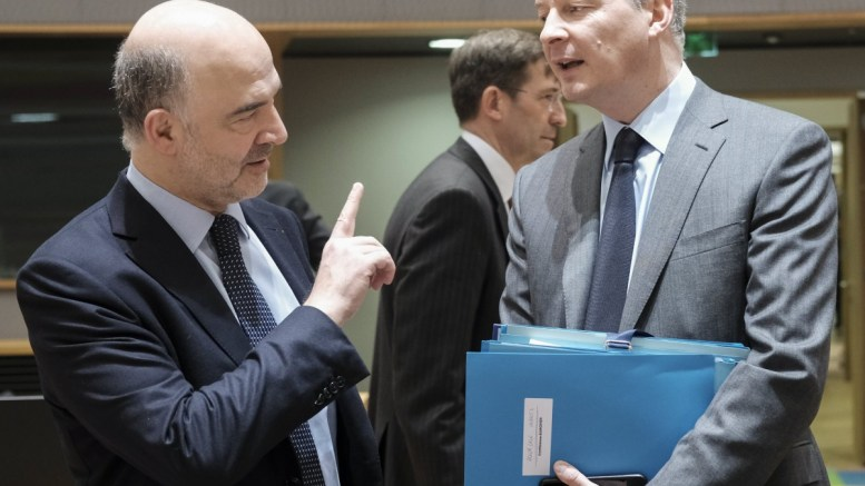 Pierre Moscovici (L), the European Commissioner for Economic and Financial Affairs, Taxation and Customs and French Finance minister Bruno Le Maire (R) during European Finance Ministers' meeting in Brussels, Belgium, 13 March 2018. The meeting of EU finance ministers will focus on measures reducing risks in banking sector. EPA, OLIVIER HOSLET