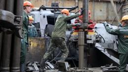 File Photo: Workers of Belarusian scientific production center of geology work at the field oil of Vasilevichi, Belarus. EPA, TATYANA ZENKOVICH