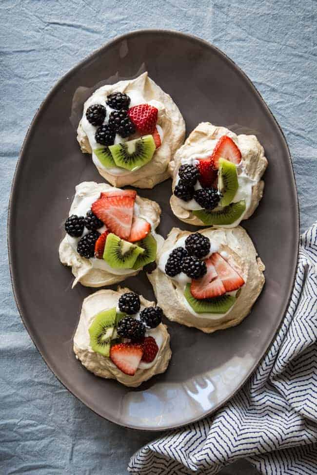 Light and airy Spring Fruit Pavlovas are filled with sweetened whipped ...