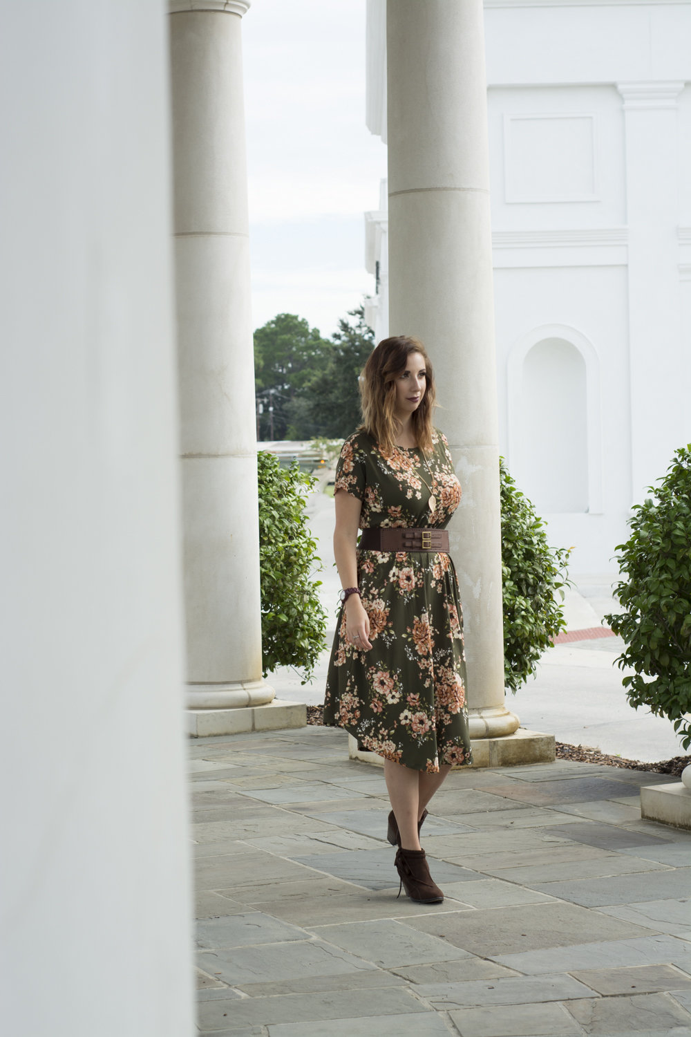 Autumn Fashion Find: Fall Floral Dress. Sharing tips and tricks on how to style a fall floral dress. This green floral dress is perfect for fall and pairs great with brown booties and subtle accessories // Hey There, Chelsie