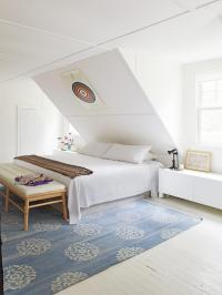 Crisp White Bedroom With Sloped Ceiling | HGTV