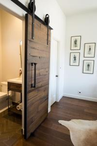 Reclaimed Wood Barn Door Gets Things Rolling In Bathroom