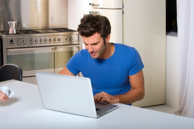 Man w Laptop Kitchen Table ID-10044212 2
