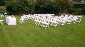 White Wedding Chairs set up for an outdoor ceremony on a sunny day!!!