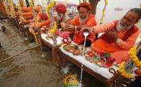 Sadhus performing puja at Kumbh Mela 2013