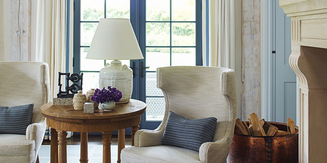 A Large Dining Room Is Flooded With Natural Light From The