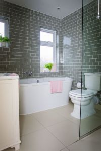 Bathroom makeover: Grey brick tiles and pink accessories ...