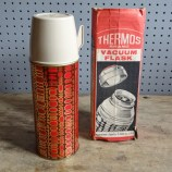 Boxed red Thermos vacuum flask