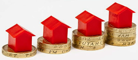 Red Monopoly houses on pound coins