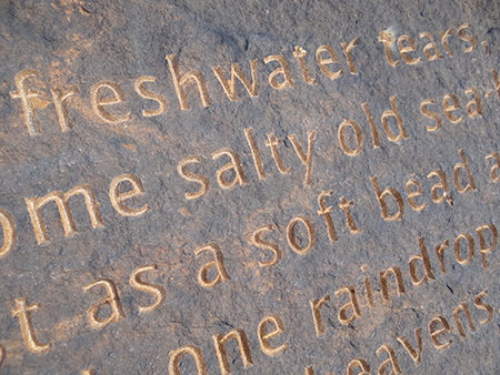 detail of Simon Armitage's 'Rain' poem carved into rock at Cow's Mouth Quarry, near Blackstone Edge on the West Yorkshire/Greater Manchester border