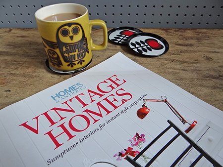 Homes and Antiques' 'Vintage Homes' book with vintage Hornsea Pottery Zodiac mug and metal coaters