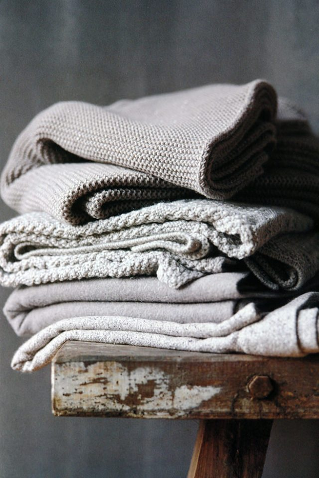 Pile of textiles in various shades of grey