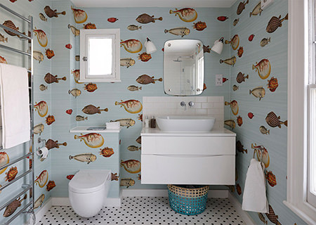 bathroom with bold fish wallpaper