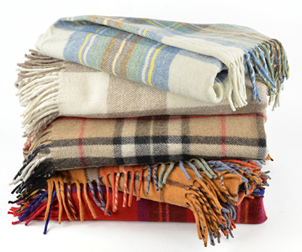 pile of tartan blankets available from Buy-a-Kilt