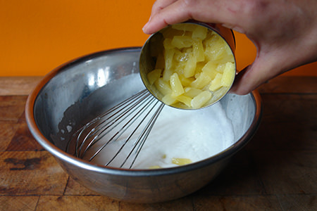 Adding pineapple to egg white, milk and vegetable oil mixture
