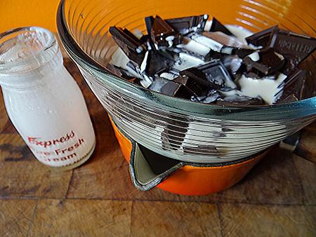 Melting dark chocolate with double cream to make a ganache