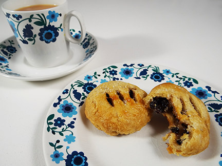 Eccles cakes with cup of tea | H is for Home
