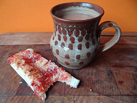 Jam coconut slice with mug of tea | @hisforhome