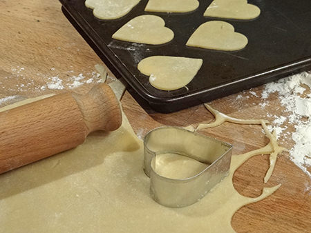 making heart shapes from biscuit pastry for jammie dodger hearts