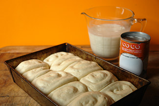 Risen panipopo dough in a rectangular baking tin | H is for Home