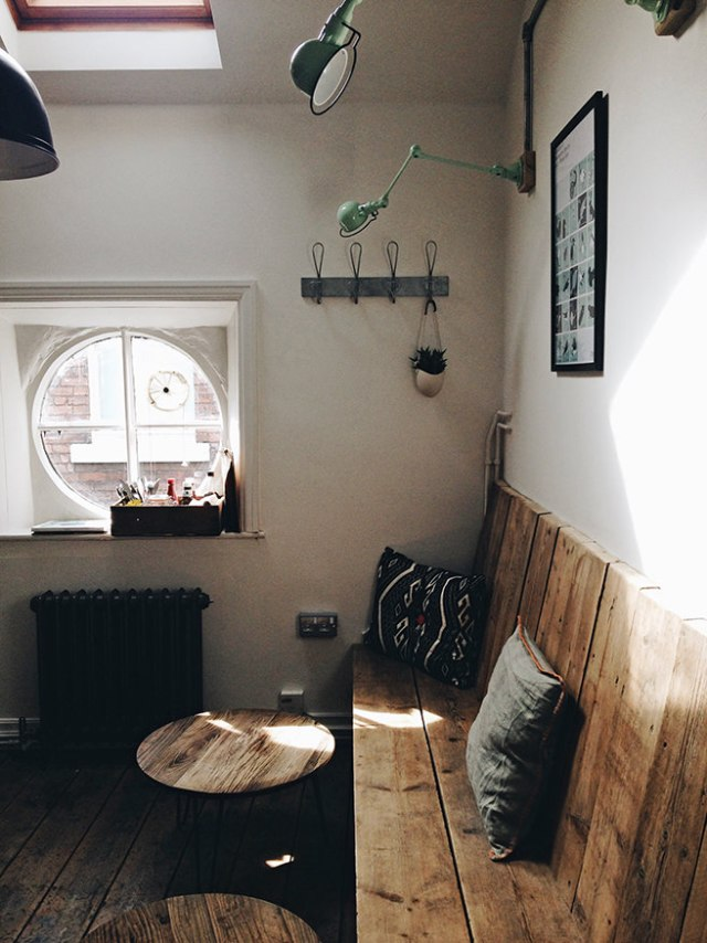 Small cast iron radiator under circular window