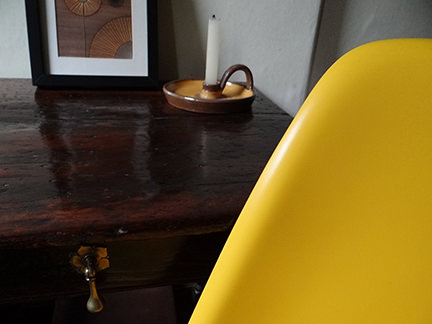 detail of reproduction yellow DSW chair from Metro Furniture