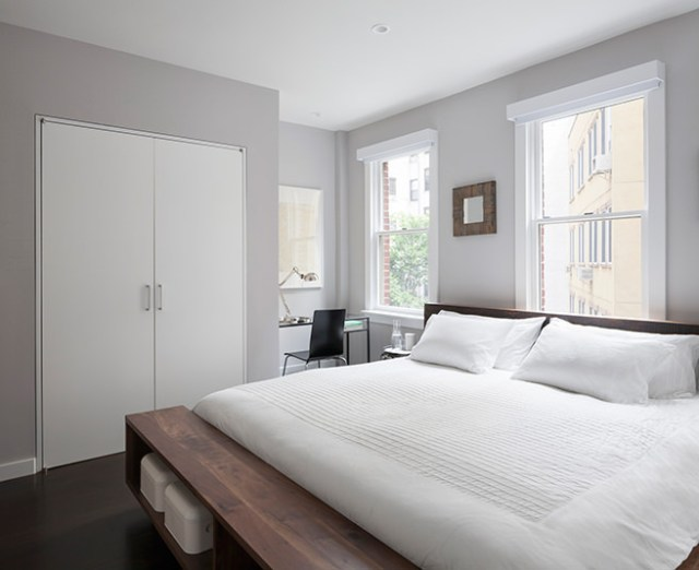 All white bedroom with white bedding