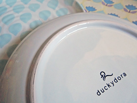 Duckydora logo on the underside of a 'Sienna' side plate