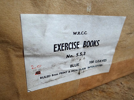 package containing vintage blue covered exercise books showing West Riding of Yorkshire County Council label