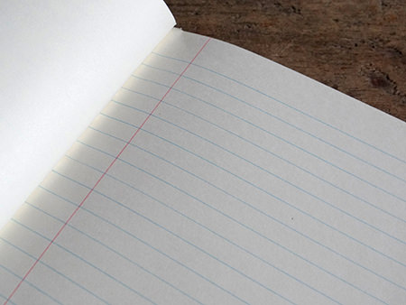 vintage blue covered exercise book showing lined page