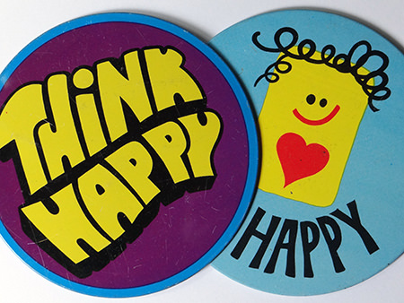 pair of large vintage happy badges