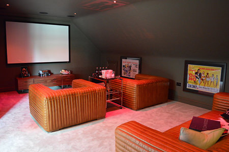 home cinema with tan club chairs
