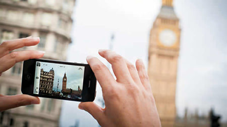 filming the Houses of Parliament with a mobile phone