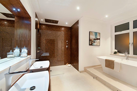 Chestnut coloured shower enclosure in a white bathroom