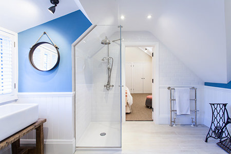 White bathroom with cornflower blue feature wall