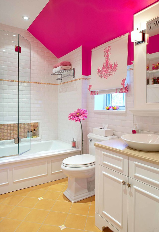 White bathroom with hibiscus pink painted feature wall