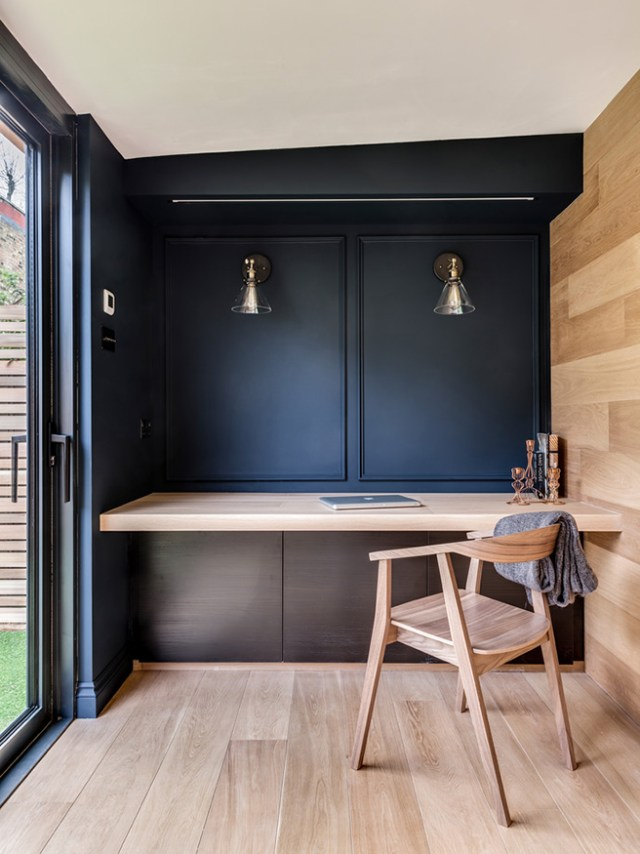 Minimalist home office with indigo painted wall