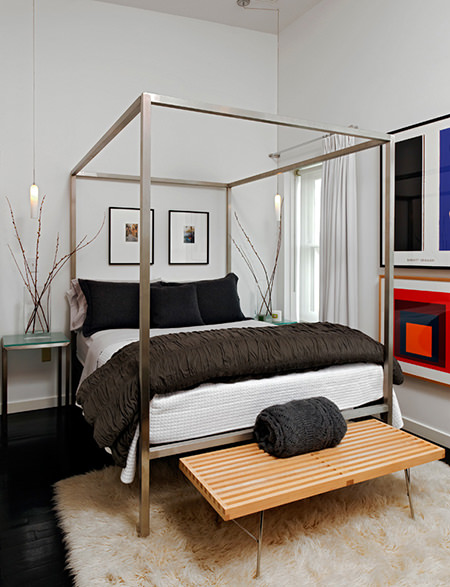 steel four-poster bed