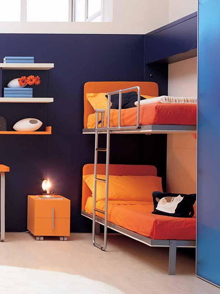 bunk beds in a dark blue painted children's bedroom