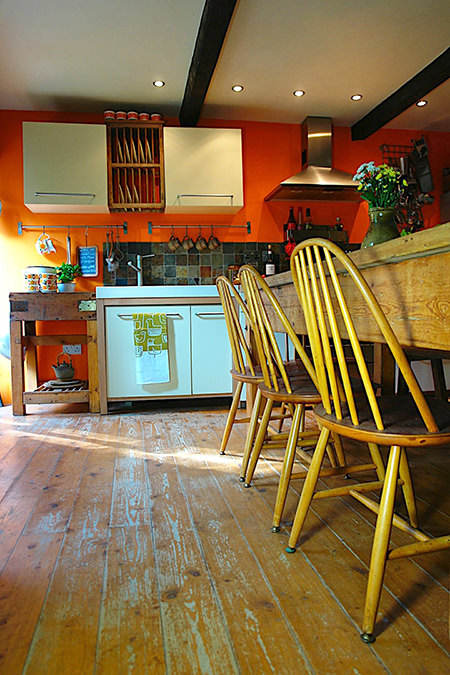 Our kitchen with orange feature wall