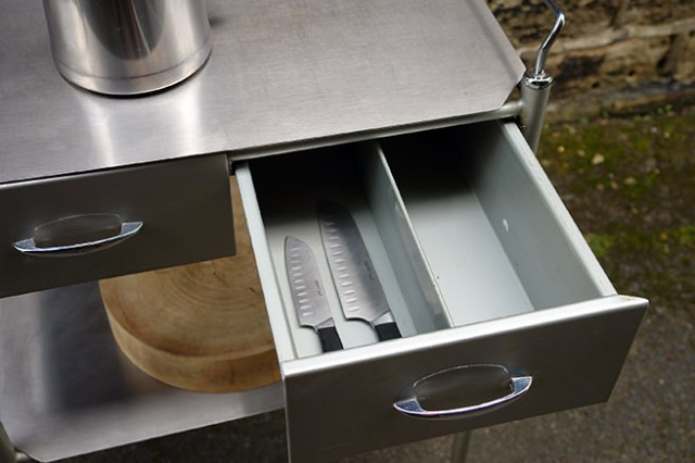 Open drawer showing chef's knives on a vintage hospital trolley | H is for Home