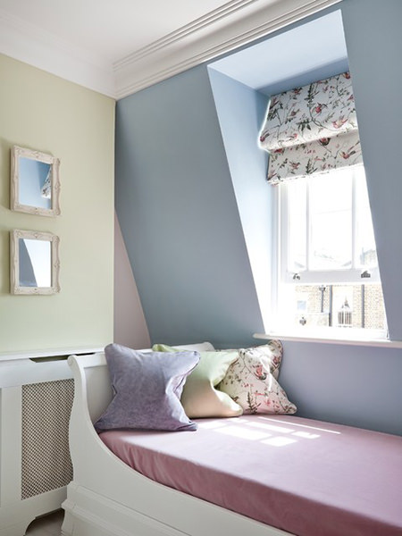 Pastel colour painted kid's bedroom with floral roman blinds