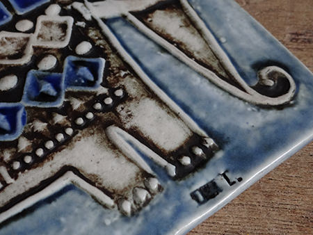 Detail from a vintage Gustavsberg Lisa Larson elephant tile showing signature stamp