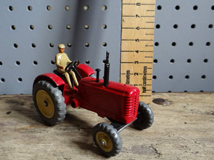 red vintage miniature tractor