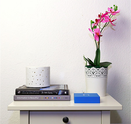 nCube smart hub on a side table