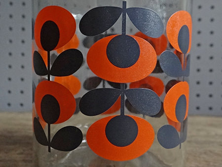 detail of a Douwe Egberts coffee jar with orange Orla Kiely pattern