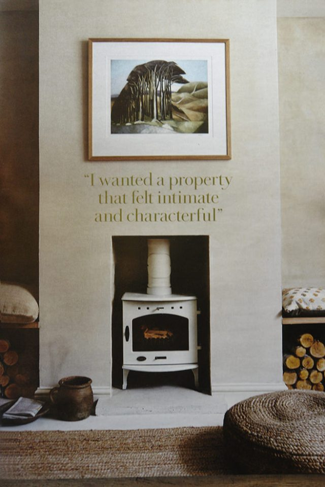 Sitting room with cream coloured wood burning stove from the 'Less is More' article in the May 2016 edition of Country Living magazine