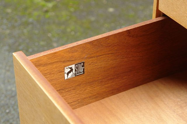 Open drawer on vintage Stag Furniture chest of drawers showing the logo | H is for Home