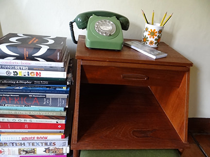 vintage teak telephone table with green GPO telephone and stack of books