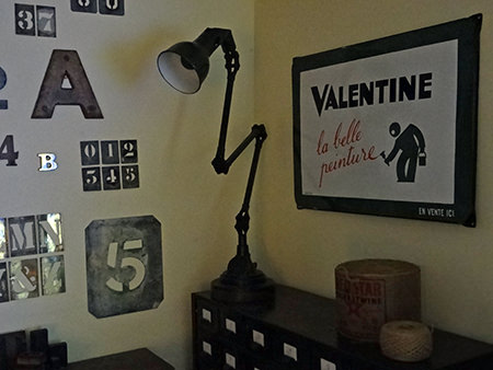 Vintage Valentine enamel sign in our sitting room with other vintage industrial homewares